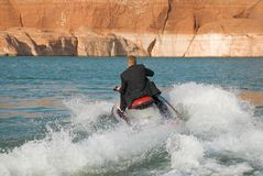 Business Travel - James Bond style. A James Bond moment for a businessman or student in a suit on a seadoo Stock Images