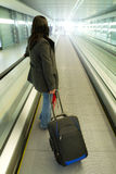 Business travel with luggage. Business woman travel with luggage on the airport Stock Image