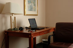 Business travel - mobile office. Laptop set up on a hotel room desk, the business traveller's mobile office Stock Images