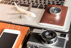 Business travel objects on laptop computer for Business travel Royalty Free Stock Photos