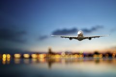 Business travel. Perspective view of jet airliner in flight with bokeh background stock photo