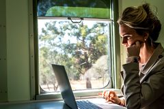 Business Travel on a Train Working and Exploring stock photos