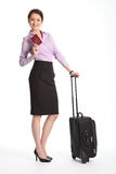 Business travel woman holding british passport Royalty Free Stock Photos