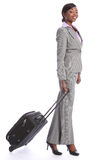 Business travel young happy black woman with case Royalty Free Stock Photography