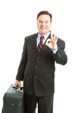 Business Traveler - AOkay. Business traveler with his luggage, giving the A Okay sign to show he's had a good trip.  Isolated on white Royalty Free Stock Photos