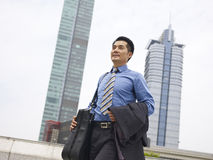 Business traveler. Asian business traveler walking on street Royalty Free Stock Photography