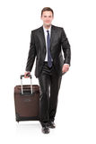 Business traveler carrying a suitcase Stock Photos
