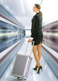 Business traveler with luggage stock photo