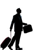 Business traveler man  lost looking up. One caucasian business traveler man walking with suitcase lost looking up  full length silhouette in studio isolated Stock Photography