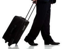 Business traveler or pilot with suitcase. A business traveler or pilot with suitcase on white background Stock Images