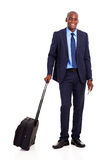 Business traveler portrait. African american business traveler full length portrait isolated on white Royalty Free Stock Images