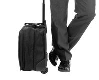 A business traveler with suitcase. On white background Royalty Free Stock Photos