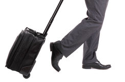 A business traveler with suitcase. On white background Royalty Free Stock Photography