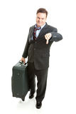 Business Traveler- Unhappy. Dissatisfied business traveler giving thumbs down on his travel experience Stock Photography