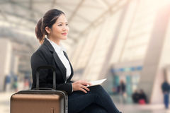 Business traveler. Waiting with airport background Royalty Free Stock Photography