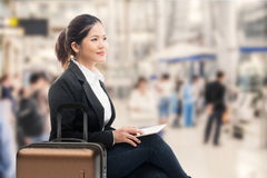 Business traveler. Waiting with airport background Royalty Free Stock Image
