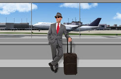 Business traveler waiting at airport. Wearing a hat Royalty Free Stock Photos
