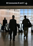 Business travelers on the move Royalty Free Stock Images