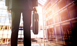 Business travelers walking in airport with luggage Stock Image