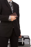 Business traveling pulling suitcase Royalty Free Stock Images