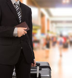 Business traveling pulling suitcase Stock Image