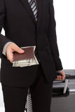 Business traveling pulling suitcase and holding Royalty Free Stock Photos