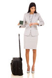 Business traveller checking time Stock Photography
