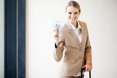 Business traveller holding money Stock Photo