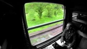 Business traveller looks through the window during train trip. stock footage