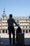 Business traveller man calling at Plaza Mayor square Stock Image