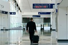 Business traveller in terminal. Walking to his gate Royalty Free Stock Image