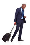 Business traveller walking. African american business traveller walking on white Stock Image