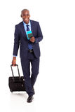 Business traveller walking. African american business traveller walking on white Stock Photography
