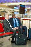 Business travellers flight Stock Photography