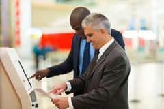 Business travellers machine Stock Image