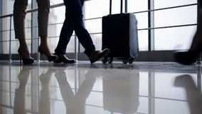 Business travellers walking in airport with luggage. Lovers run to the airport check-in. Love in the journey stock footage