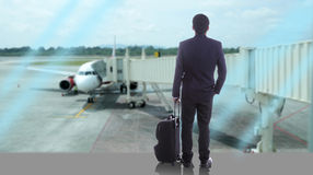 Business travellers walking over the sea Royalty Free Stock Photography