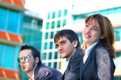 Business Trio 3. Three young business coworkers, one woman and two men, outside an office building Stock Photography