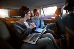 Business trip- colleagues working together in back seat Stock Photography