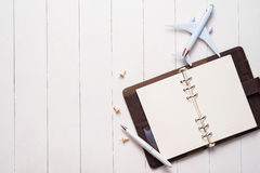 Free Business Trip Concept. Airplane And Blank Open Notebook For Your Royalty Free Stock Images - 91482639