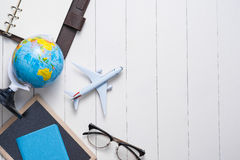 Business trip concept. Airplane and blank open notebook for your. Text Stock Photos