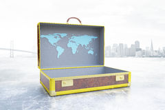 Business trip concept. Side view of open suitcase with drawn map on city background. Business trip concept, 3D Rendering Stock Photos