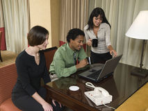 Business trip - happy laptop team Royalty Free Stock Photo