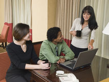 Business trip - happy laptop team Stock Photography