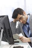Business trouble. Troubled businessman reading newspaper, financial news Royalty Free Stock Photos