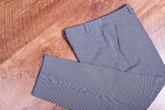 Business trousers folded on laminate stock photo