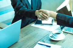 Business trust commitment which Business Partners holding hands stock images