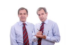 Business twins. Business male twins isolated over white Royalty Free Stock Photos