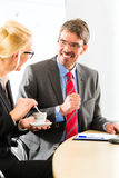 Businesspeople in business office drink coffee Stock Photography