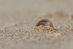 Business Ukraine coins at holiday in the sand on the beach, North Sea Royalty Free Stock Photos